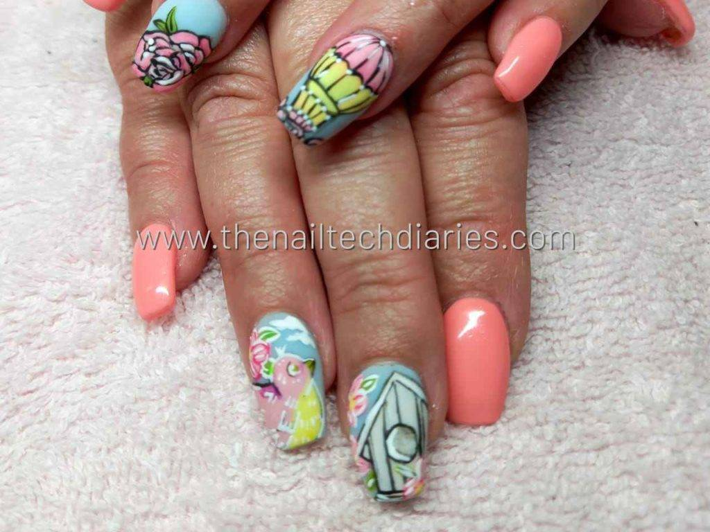 18. Colorful hand-painted nail art