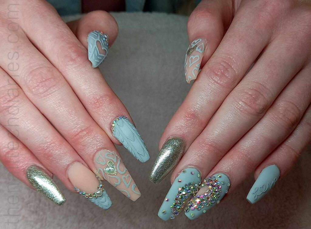 Sweater 3d nails. Baby blue nails with rhinestones and different 3d art with the sweater effect