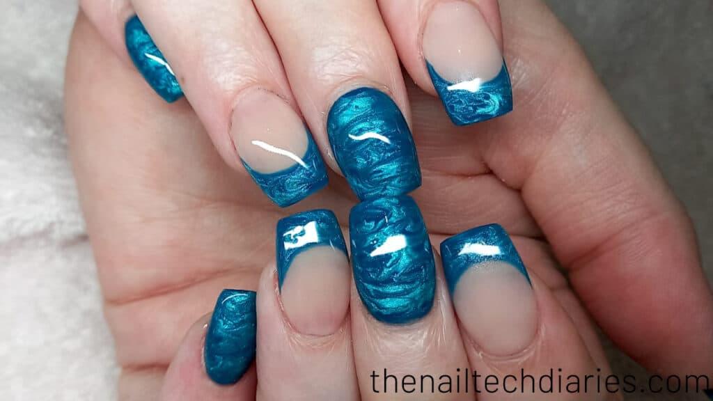 31. Metallic oceanic blue nail art