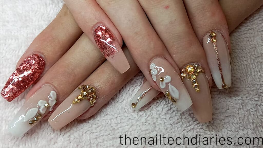 29. Nude nail art with 3D flowers