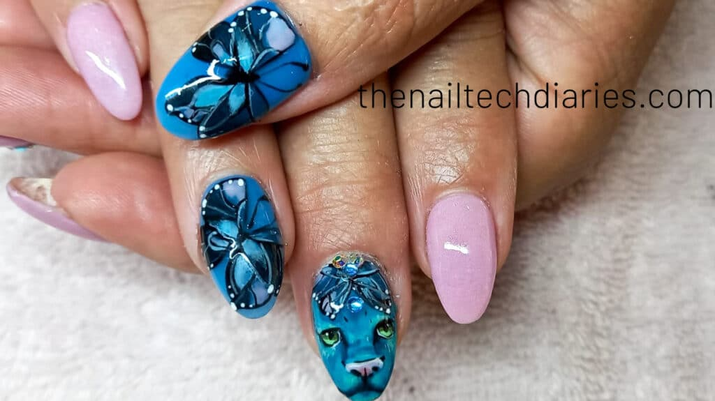 26. Puma and butterfly tropical nail art