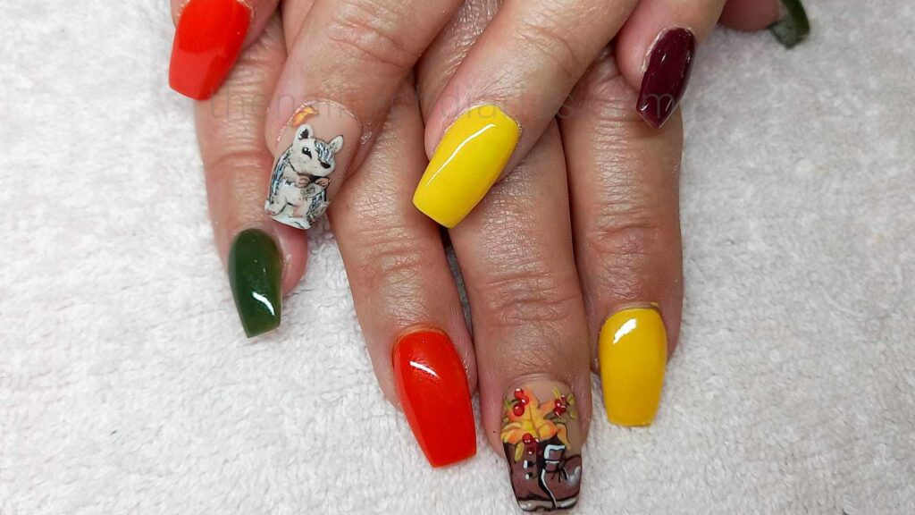 fall themed nails. Yellow and red nails with a old boot on one nail and a squirrel on the other hand on a nail