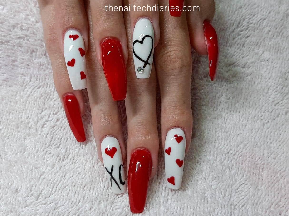 1. Red Hearts Nail Art